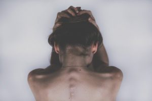 Woman holding her head